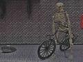 kostlivec na kole tmavší